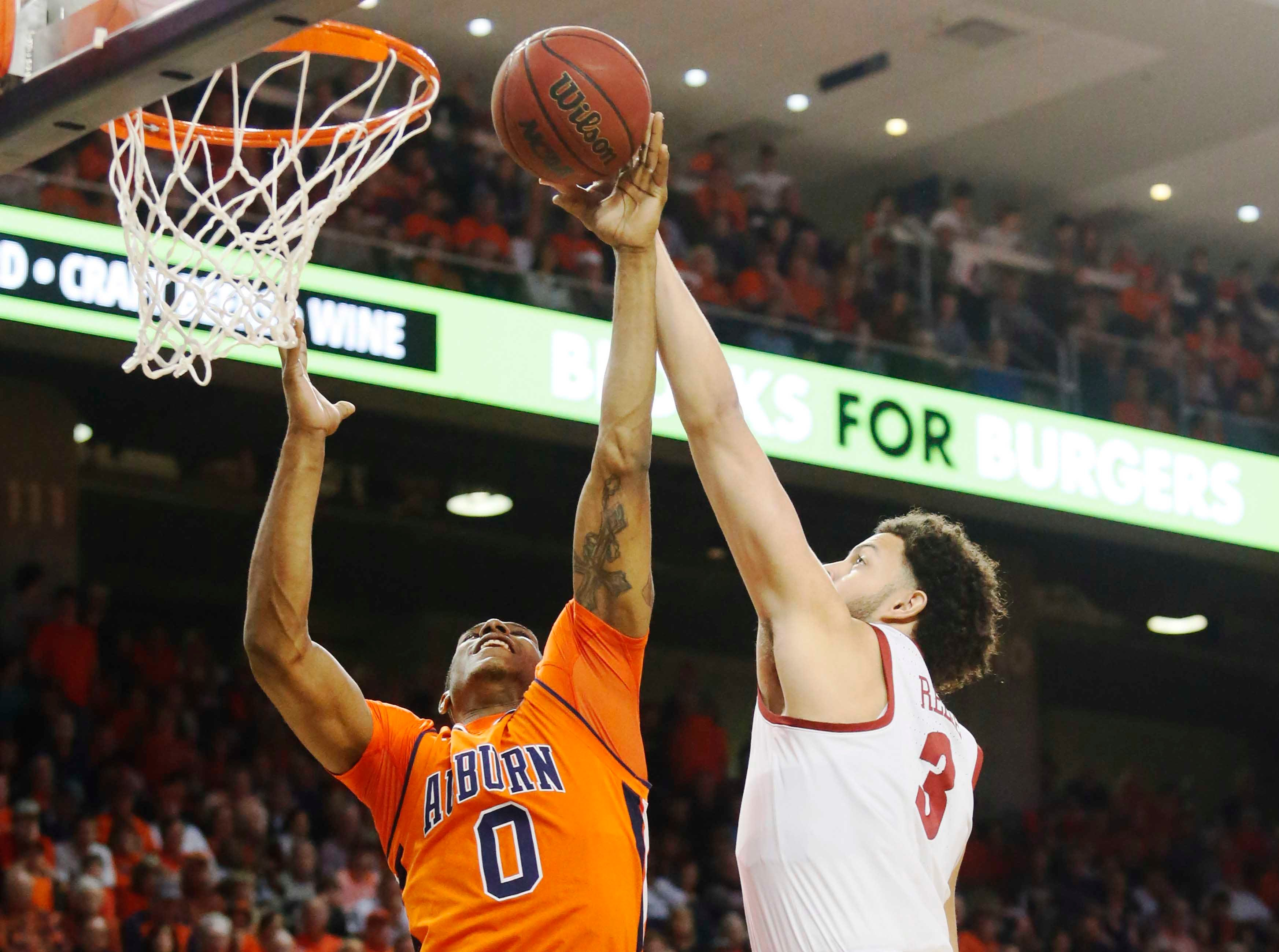 Feb 2, 2019; Auburn, AL, USA; Alabama Crimson Tide forward Alex Reese (3) battles with Auburn Tigers forward Horace Spencer (0) for a rebound during the first half at Auburn Arena. Mandatory Credit: John Reed-USA TODAY Sports