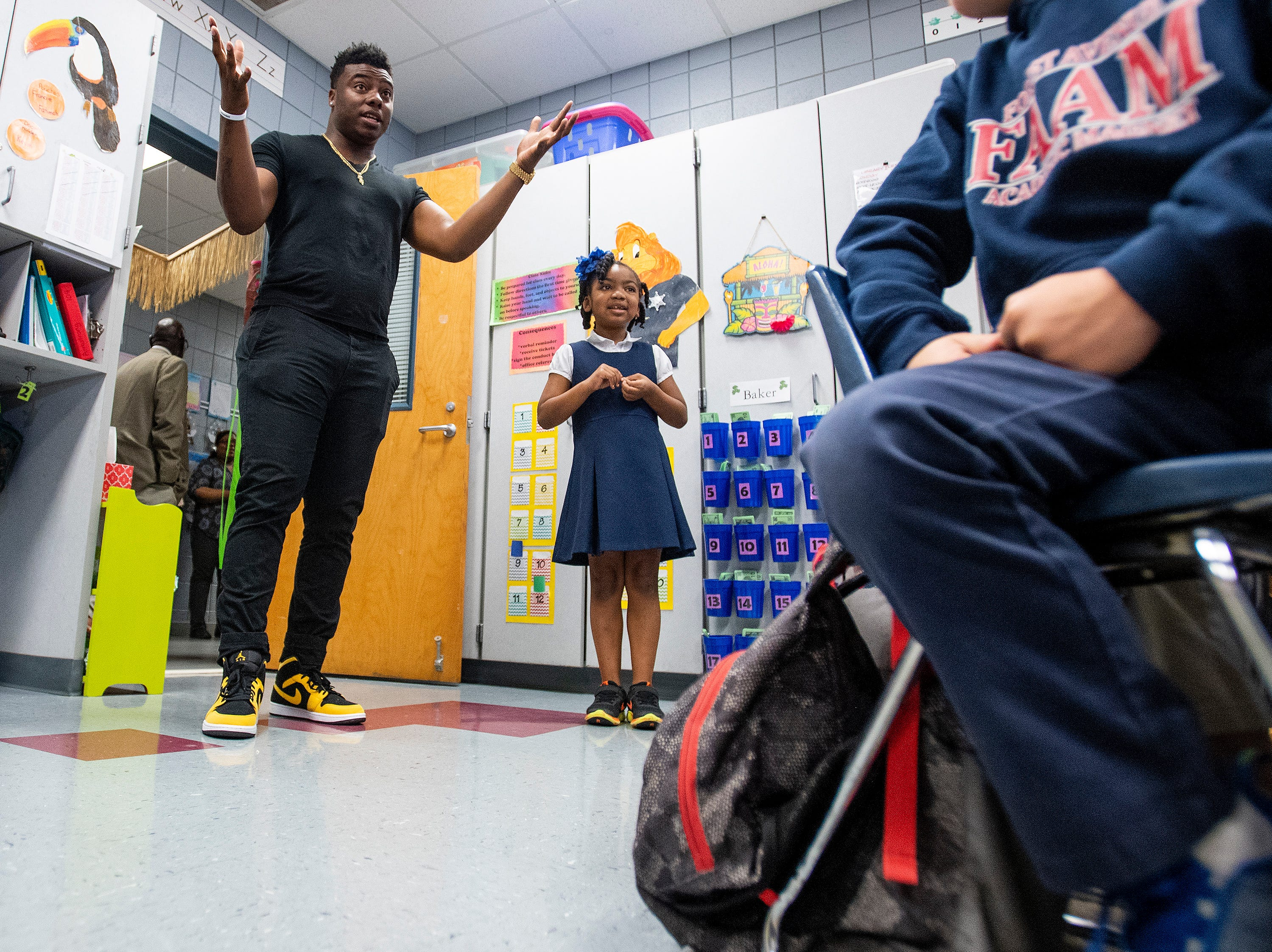 Kirk Jay, who finished third on The Voice, talks with first grade pupils with his fan McKenzie Ogletree at his side as he visits Forest Avenue School in Montgomery, Ala., on Tuesday February 5, 2019.