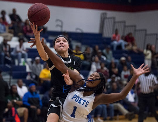 Carver's Kristin Brown (30) goes up for a layup on Lanier's Ashley Shackelford (1) at Park Crossing in Montgomery, Ala., on Monday, Feb. 4, 2019. Carver defeated Lanier 57-54.