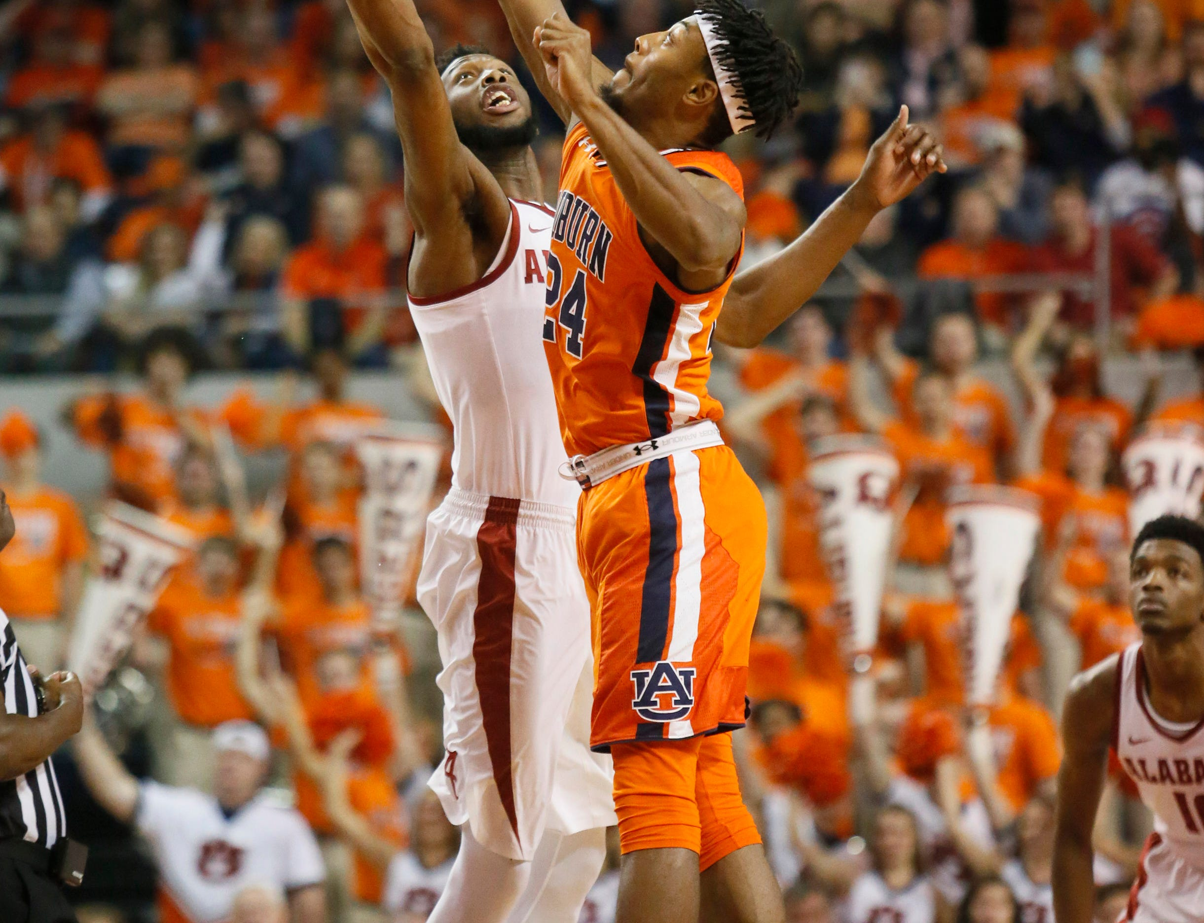 Feb 2, 2019; Auburn, AL, USA; Auburn Tigers forward Anfernee McLemore (24) and Alabama Crimson Tide forward Donta Hall (0) battle for the opening tip at Auburn Arena. Mandatory Credit: John Reed-USA TODAY Sports