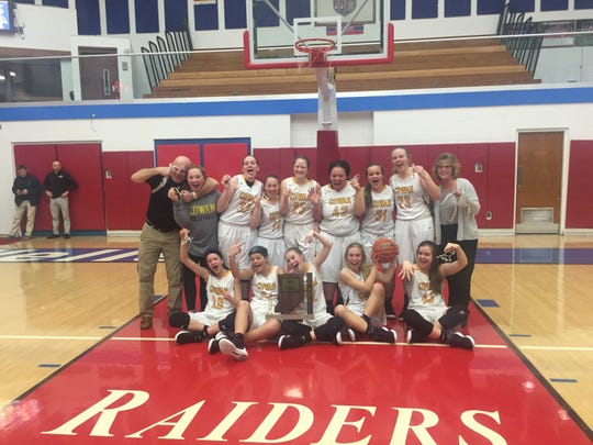 Cowan poses with the trophy after capturing the first sectional title in program history.