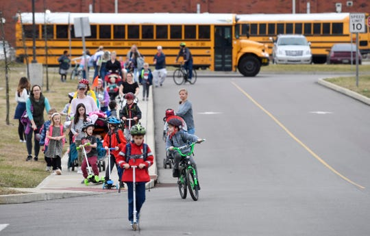 Parents and students walk home together after school. Proposed rezoning would move 202 students in  the Silver Stream Farm subdivision in Nolensville from Mill Creek Elementary to Nolensville Elementary where they won't be able to walk or bike to school Monday, Feb. 4, 2019, in Nolensville, Tenn.