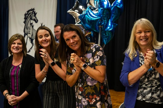 """Employees at Bonita Springs Middle School clap as social worker Paul Milford was awarded the """"School-related Employee of the Year"""" award at Bonita Springs Middle School in Bonita Springs on February 5, 2019."""
