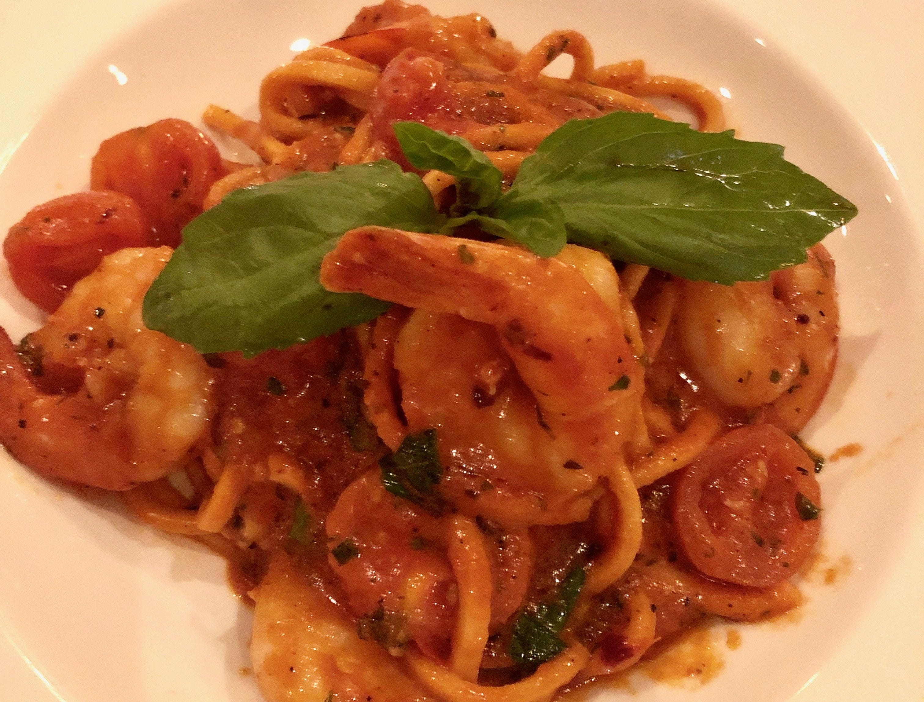 A spicy spaghetti studded with tomatoes and shrimp was on special recently at La Trattoria in downtown Naples.