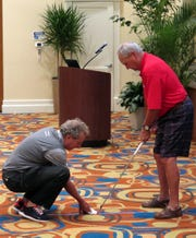 Impact Zone golf founder and instructor Bobby Clampett, a former longtime tour player and TV golf analyst, works with Bentley Village resident Mike Kell during an appearance at the Bonita Springs club on Wednesday, Jan. 30, 2019.