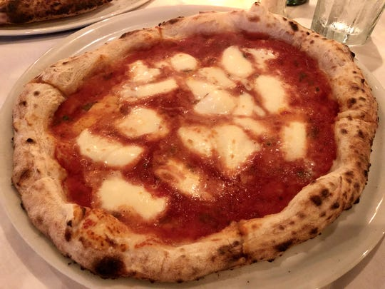 A classic margherita pizza La Trattoria in downtown Naples shows off the chef's pizza mastery.