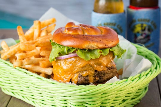 The Island Gypsy Cheeseburger with fries is the Island Gypsy Poolside Cafe's take on a cheeseburger in paradise.