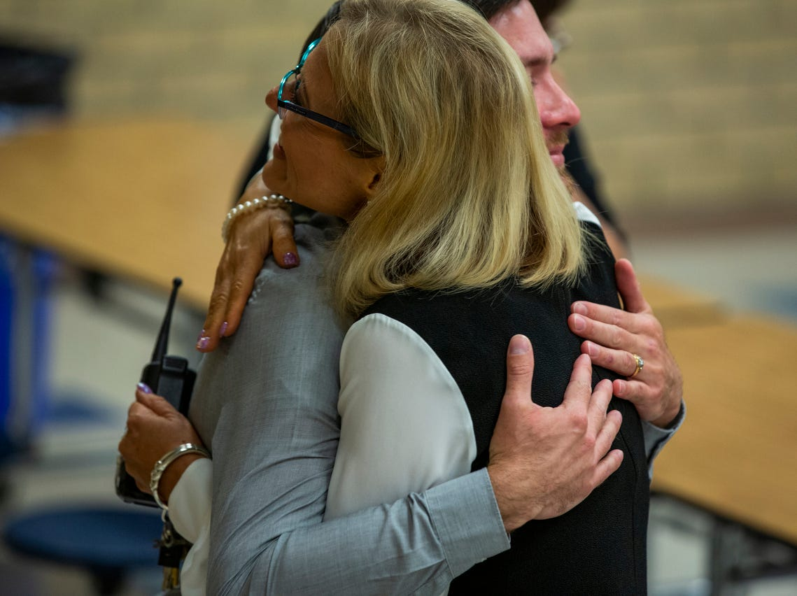 "Social worker Paul Milford hugs Principal Melissa Laymer after Milford was surprised with the ""School-related Employee of the Year"" award at Bonita Springs Middle School in Bonita Springs on February 5, 2019."