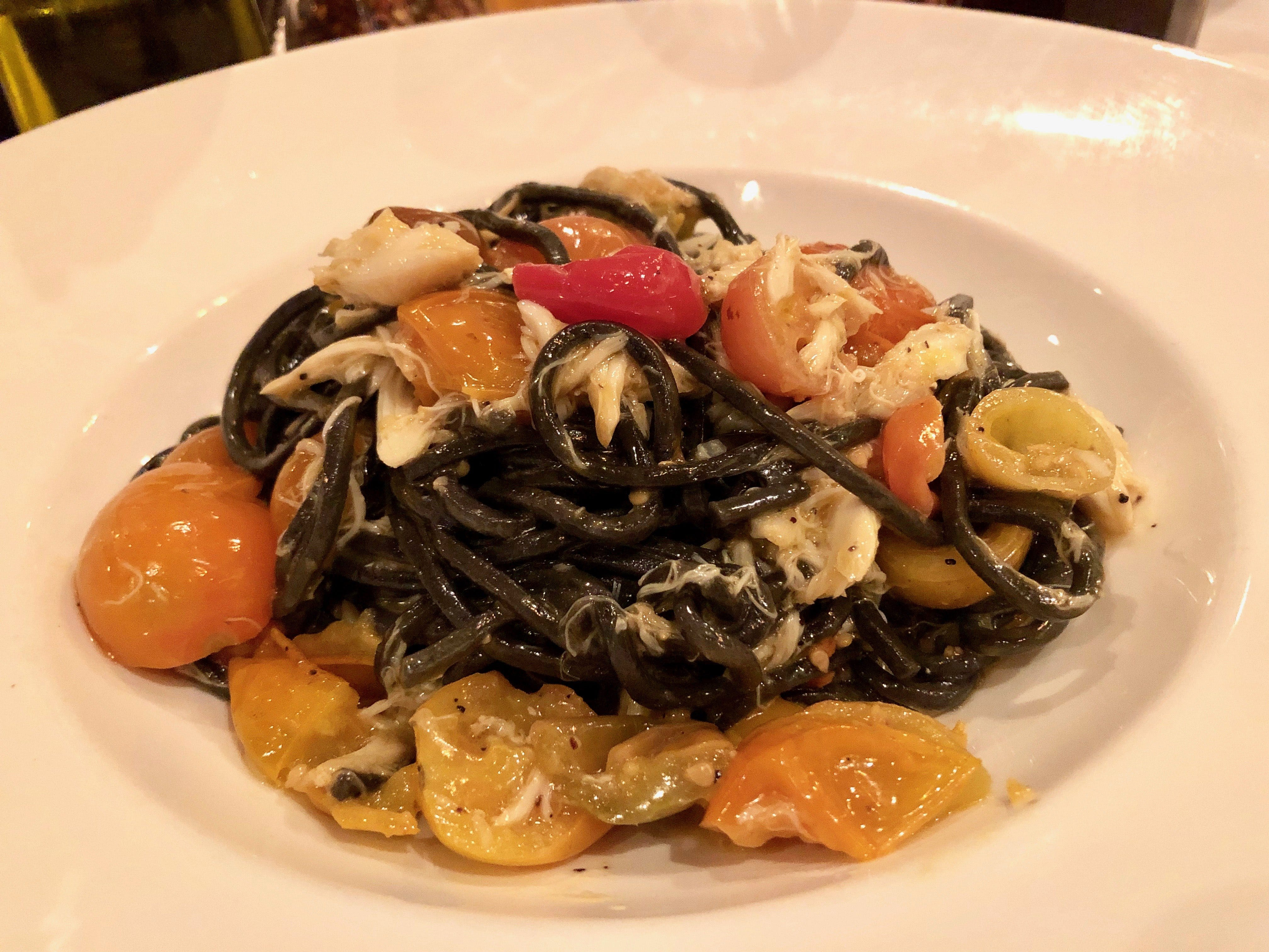Squid-ink linguine is slicked in a luscious butter and white wine sauce at La Trattoria in downtown Naples.