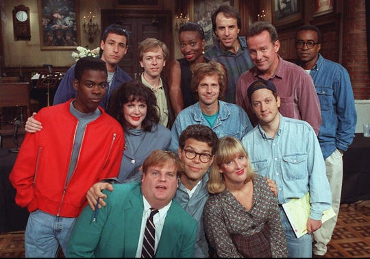 "-  -FILE-- The cast of NBC's ""Saturday Night Live"" pose on the show's set in New York, Sept. 22, 1992. From left, front row, are: Chris Farley, Al Franken and Melanie Hutsell. In middle row, from left, are: Chris Rock, Julia Sweeney, Dana Carvey and Rob Schneider. In back row, from left, are: Adam Sandler, David Spade, Ellen Cleghorne, Kevin Nealon, Phil Hartman and Tim Meadows.  (AP Photo/Justin Sutcliffe,File)"