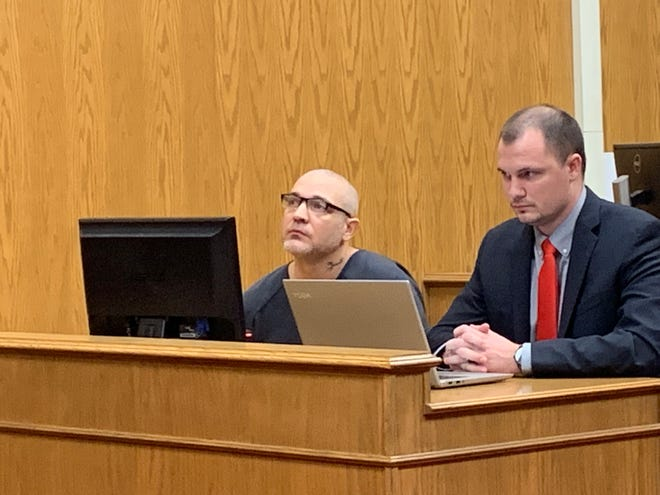 Kevin Richards (left) listens to Judge David Branstool beside his attorney during a sentencing hearing Tuesday, Feb. 5, 2019.
