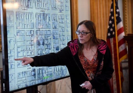 Kathy Mosholder points out her former residence during her testimony in court on Tuesday, Feb. 5, 2019. Kathy Mosholder was one of three residents there the night David Barcus was shot and killed in the Cherry Street home.