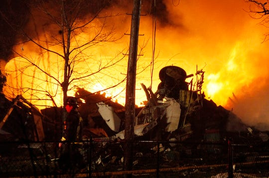 FILE - In this Feb. 12, 2009, file photo, a plane burns after it crashed into a house in Clarence Center, N.Y.,  Authorities say it was Continental Airlines Flight 3407 operated by Manassas, Va.-based Colgan Air.  Airline industry and safety officials are concerned that pilots' flying skills are becoming rusty and their ability to handle unexpected situations is eroding because most flying is delegated to computers in today's highly automated planes.