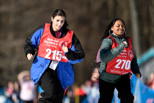 Alexa Faria of Forked River, left, and Zaniyah Bullock of Newark, right, compete in the snowshoeing 200-meter during the Special Olympics New Jersey 2019 Winter Games on Tuesday, Feb. 5, 2019, in Vernon.