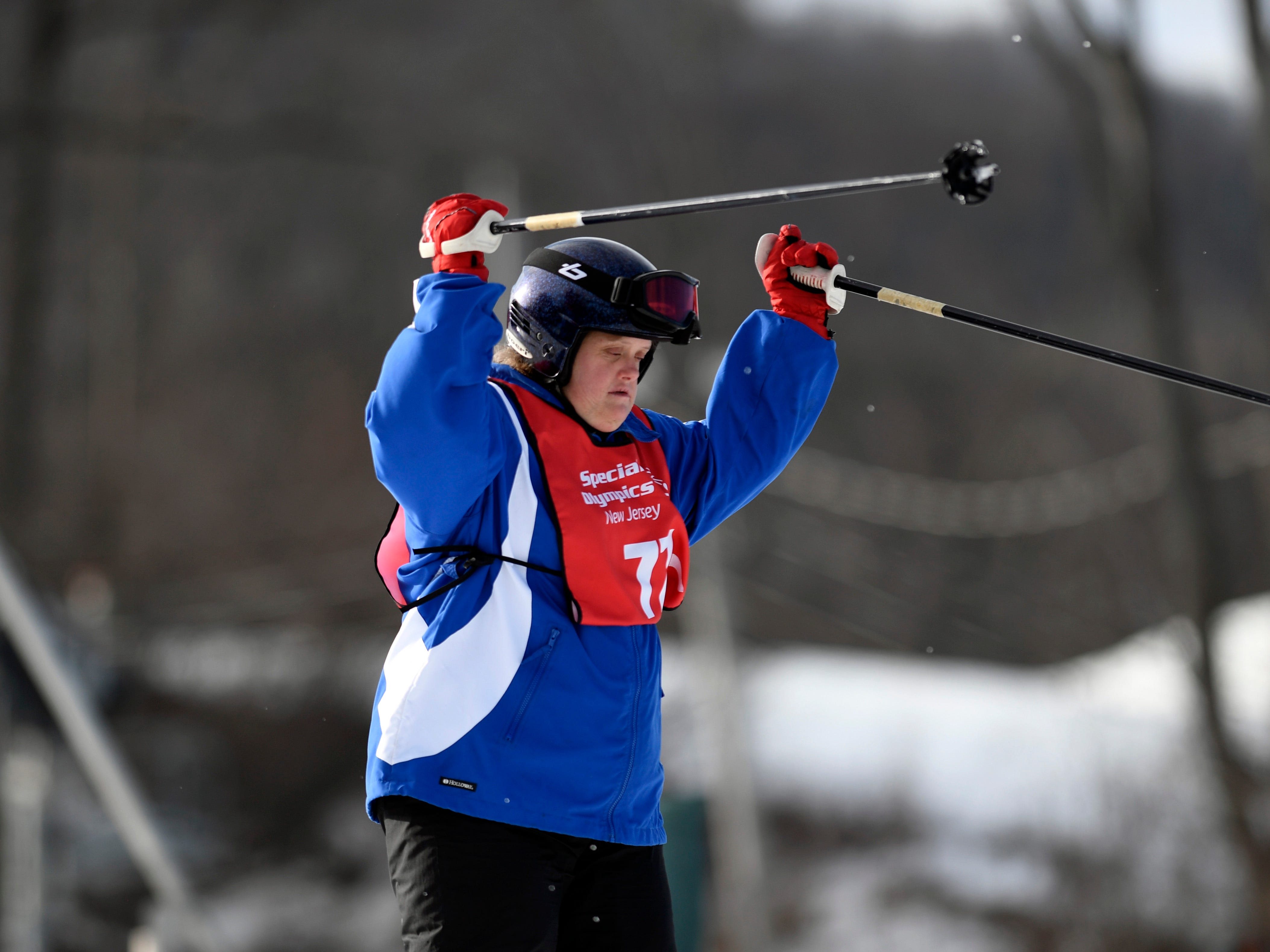 Linda Kent of Paramus holds her skis up in the air as she crosses the finish line of the giant slalom during the Special Olympics New Jersey 2019 Winter Games on Tuesday, Feb. 5, 2019, in Vernon.