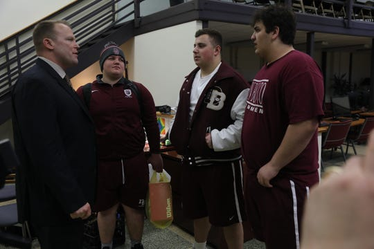The new head football coach at Don Bosco Dan Sabella arrives for his introduction and is greeted by some of his players