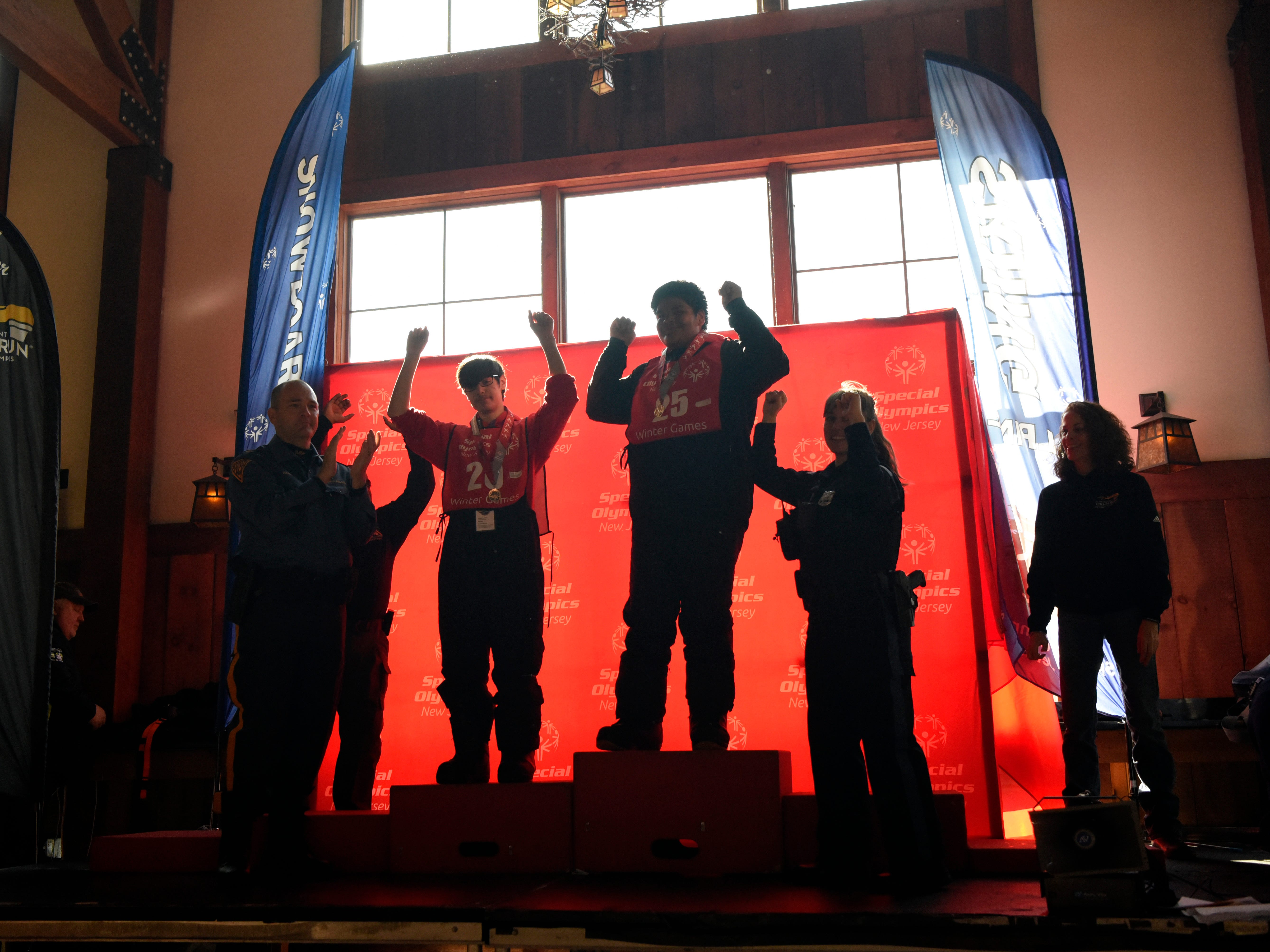 Athletes celebrate during a medal ceremony at Mountain Creek Ski Resort during the Special Olympics New Jersey 2019 Winter Games on Tuesday, Feb. 5, 2019, in Vernon.