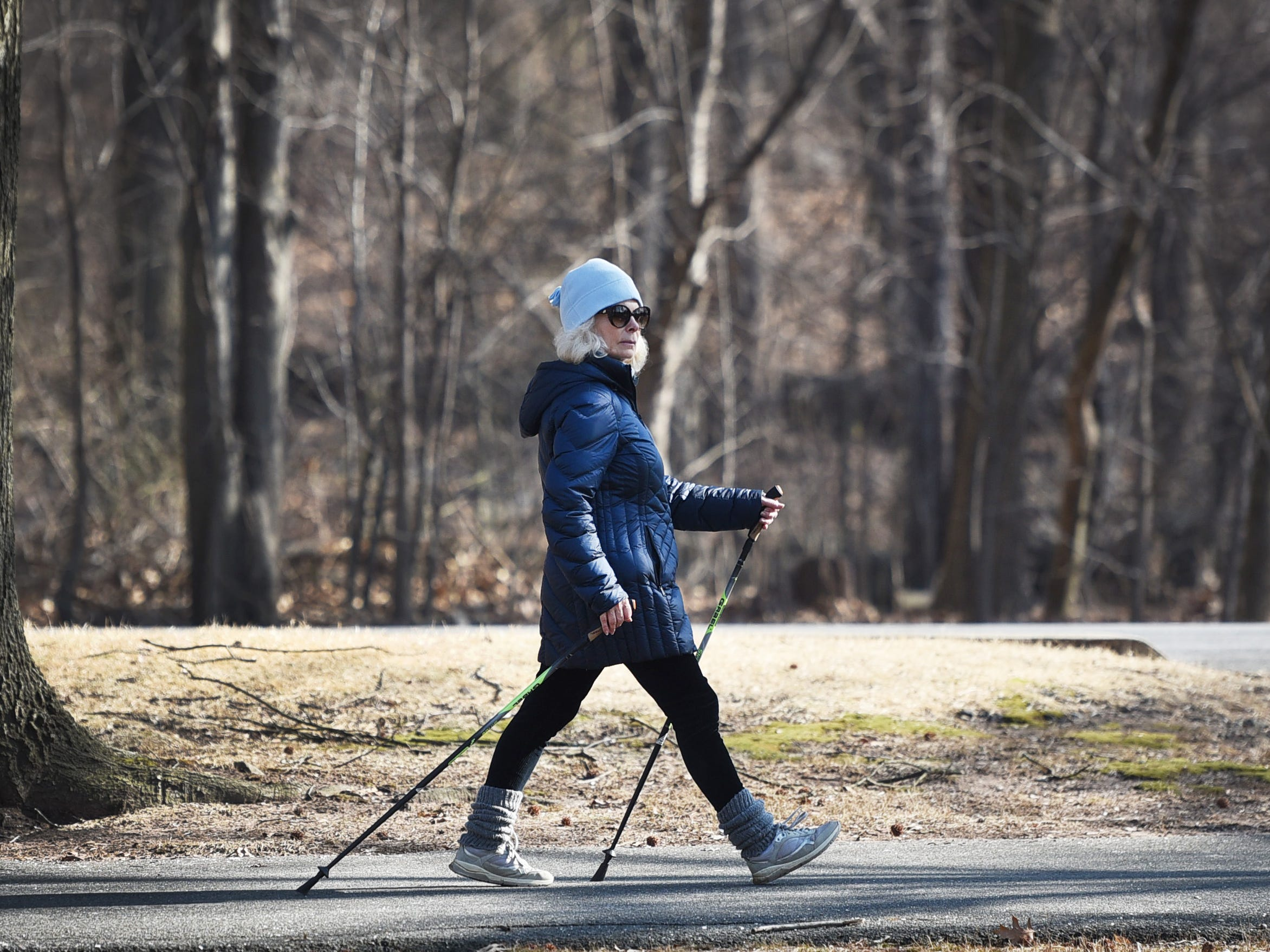 A woman walks with with two sticks at Van Saun County Park in Paramus on 02/05/19.