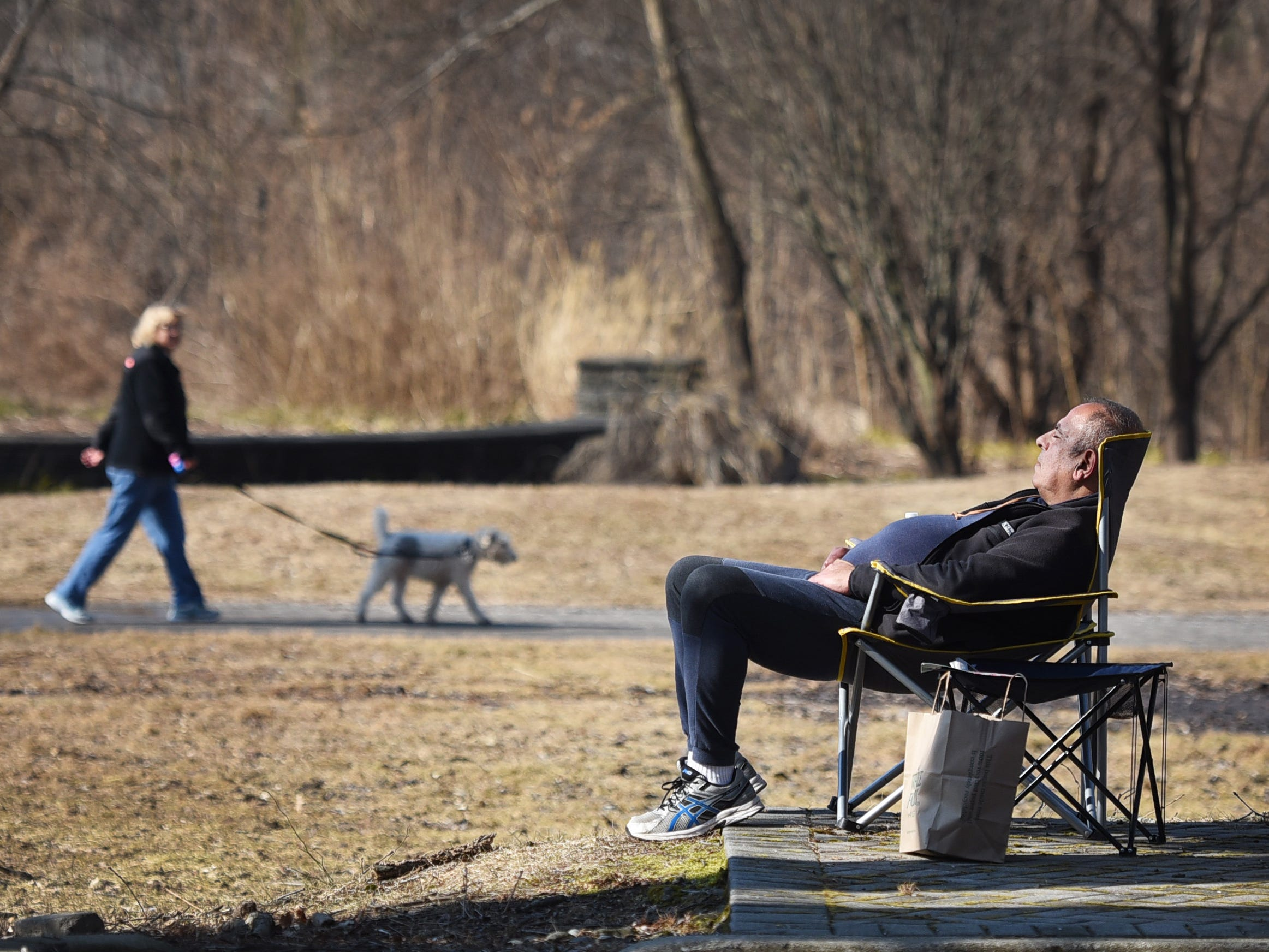 A man catches some rays as he relaxes in a chair at Van Saun County Park in Paramus on 02/05/19.