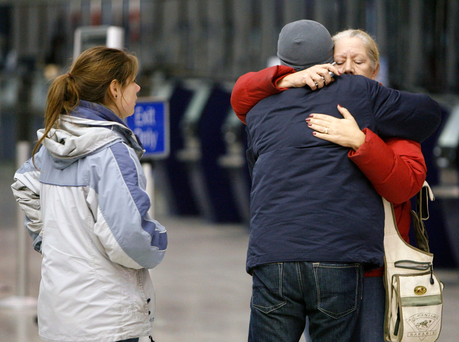 """""""Family members leaver the Buffalo Niagara Airport on Thursday, Feb. 12, 2009 after Continental Airlines Flight 3407 crashed into a home in Clarence Center, N.Y. The commuter plane """"""""basically dove"""""""" into a house while coming in for a landing, sparking a fiery explosion that killed all 48 people on board and one person on the ground, an emergency official said Friday. (AP Photo/The Buffalo News,Harry Scull Jr)"""""""