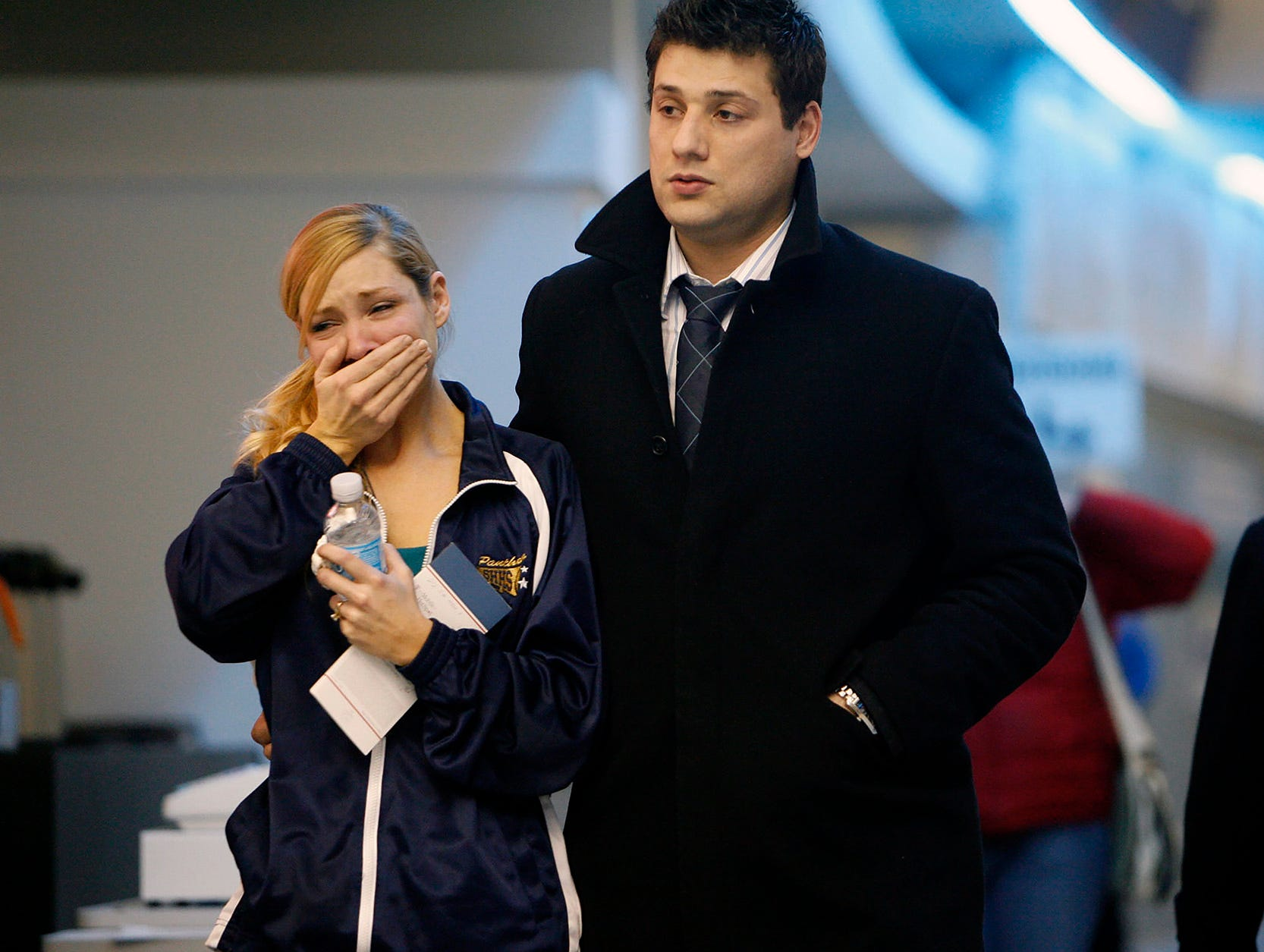 Family members leave the Buffalo Niagara Airport on Thursday, Feb. 12, 2009 after Continental Airlines Flight 3407 crashed into a home in Clarence Center,N.Y.