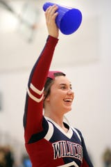Sophomore Wildcat Cheerleader Maison Treadwell prepares to launch a mini megaphone during a time out of the Deming High basketball game. Treadwell and her Wildcat cheer teammates keep a hectic performance schedule and manage to fine time to practice for district and state competition.