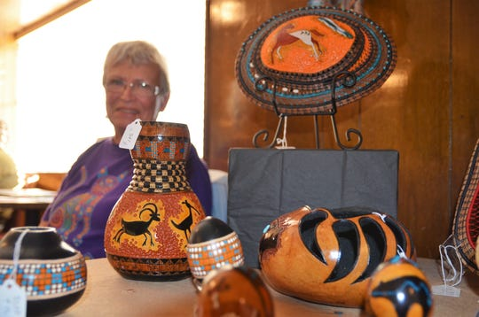 Local artist Susan Schiffner had her painted gourds on display last Friday at the Grand Motor Inn on East Pine Street. Schiffner made a sale.