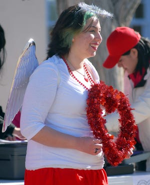 In this file photo, Erica Valdez, of Las Cruces, dresses as a Cupid the mascot for the Cupid's Chase 5K Run in the Mesilla Plaza on Saturday.