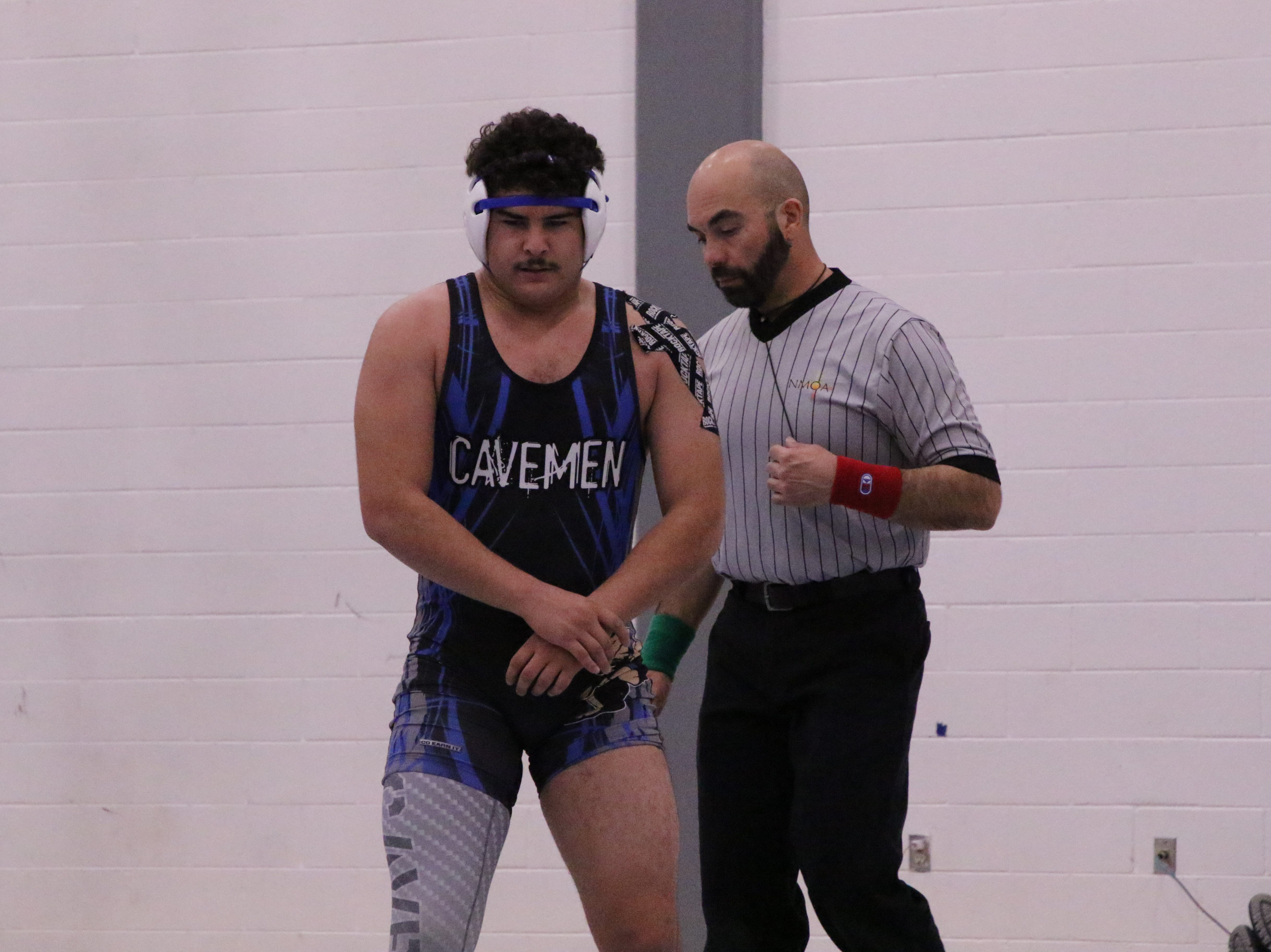 Baca mentally prepares himself to return to the mat after injuring his left shoulder.