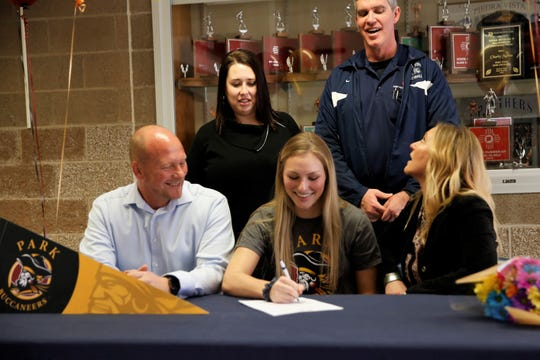 Piedra Vista's Tayln Miller signs her letter of intent on Tuesday to continue her volleyball career at newly-formed Park University west campus in Gilbert, Arizona.
