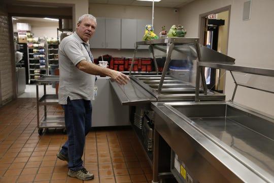Bonnie Dallas Senior Center Adult Services Director Jack Lowery shows the center's kitchen area Tuesday in Farmington.