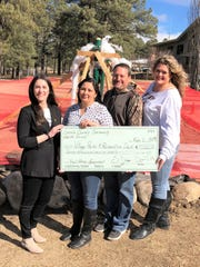 Presenting the $7,000 grant check toward the purchase of exercise equipment from left, were Lincoln County Community Health Council vice chairman Dominique M Taylor  and chairman Shannon Dictson. Accepting were  Ruidoso Parks and Recreation Director Rodney Griego and administrative assistant Melissa Haynes.