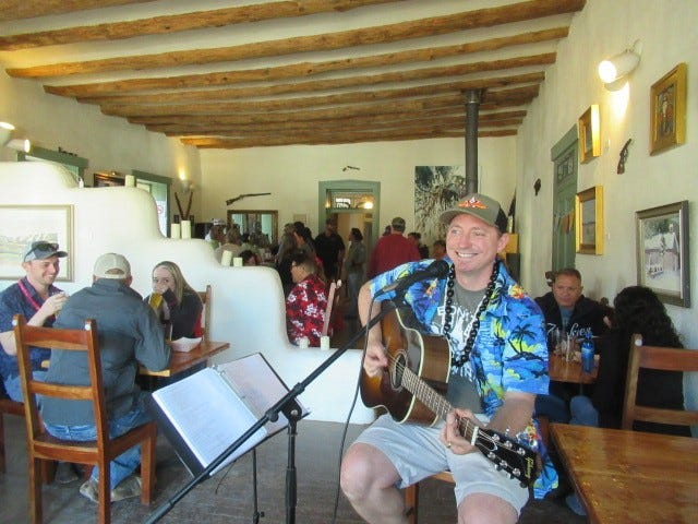 """It was standing room only during Saturday's """"Winter Luau"""" party at Lincoln's Bonito Valley Brewing Company.  The creation of Head Brewer Tim Roberts (pictured), who also performed with his guitar, the day-long celebration gave locals and visitors a chance to shrug off winter with a tropical-themed event at the region's newest brew-pub. Featuring non-stop live entertainment, drink specials and custom sandwiches from Roswell's Black Betty BBQ, the event drew crowds to the historic village, where The Beach Boys out-shot Billy the Kid for the day."""
