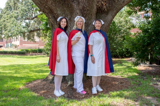 Nurses Nova McDavid, Pam Weidert and Jeanne Harris of Baptist Health Care participate in the Nursing Honor Guard program, to provide final tribute to former nurses who have passed away.