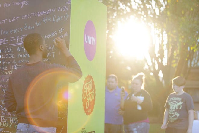 Sunday's Child's UNITY project and Courage Wall at the 2018 Foo Foo Festival.