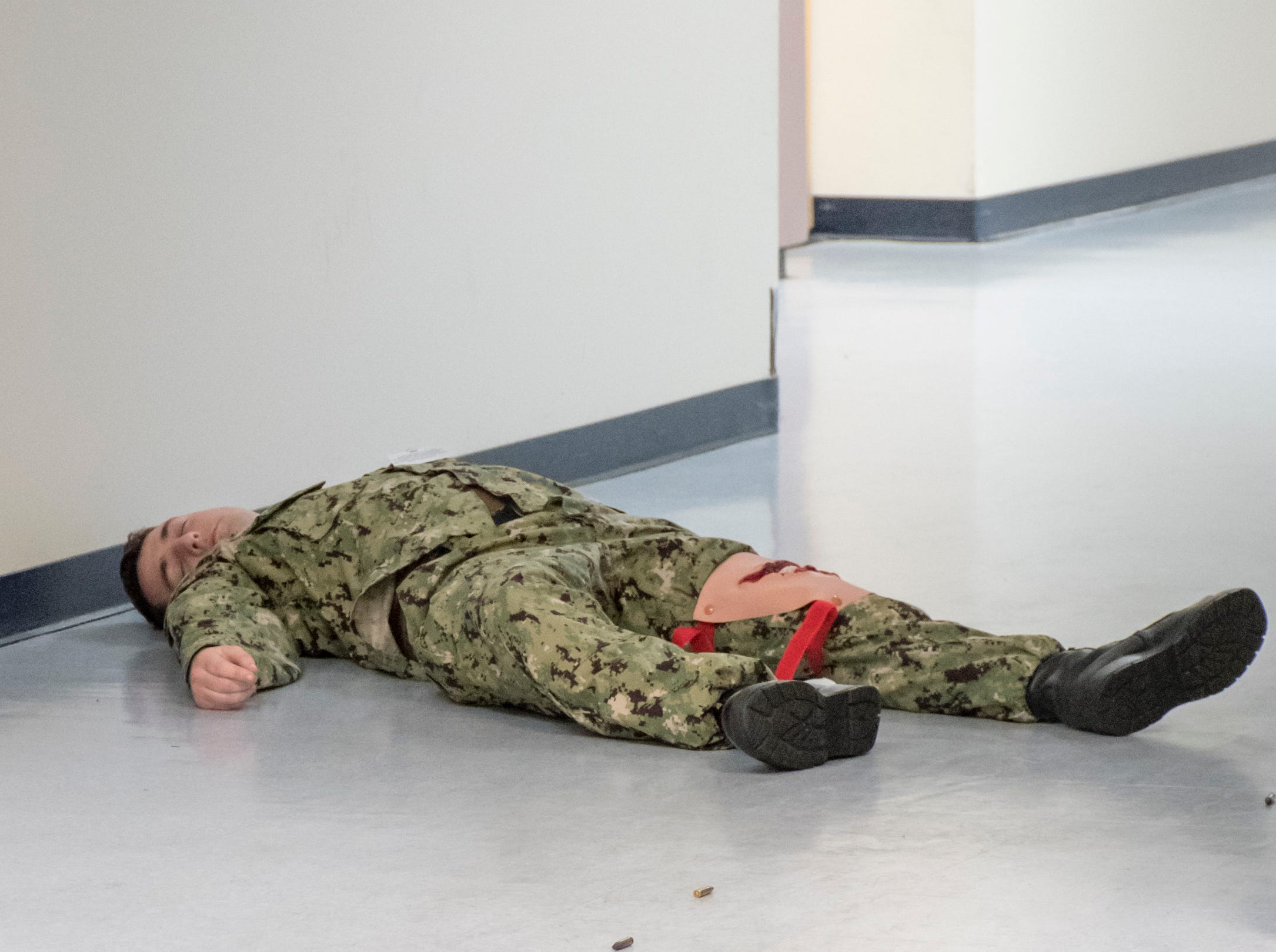 Spent shell casings lead to a sailor acting as a casualty in the Personnel Support Detachment building during the Exercise Solid Curtain-Citadel Shield, an annual security exercise is conducted at NAS Pensacola on Tuesday, February 4, 2019.