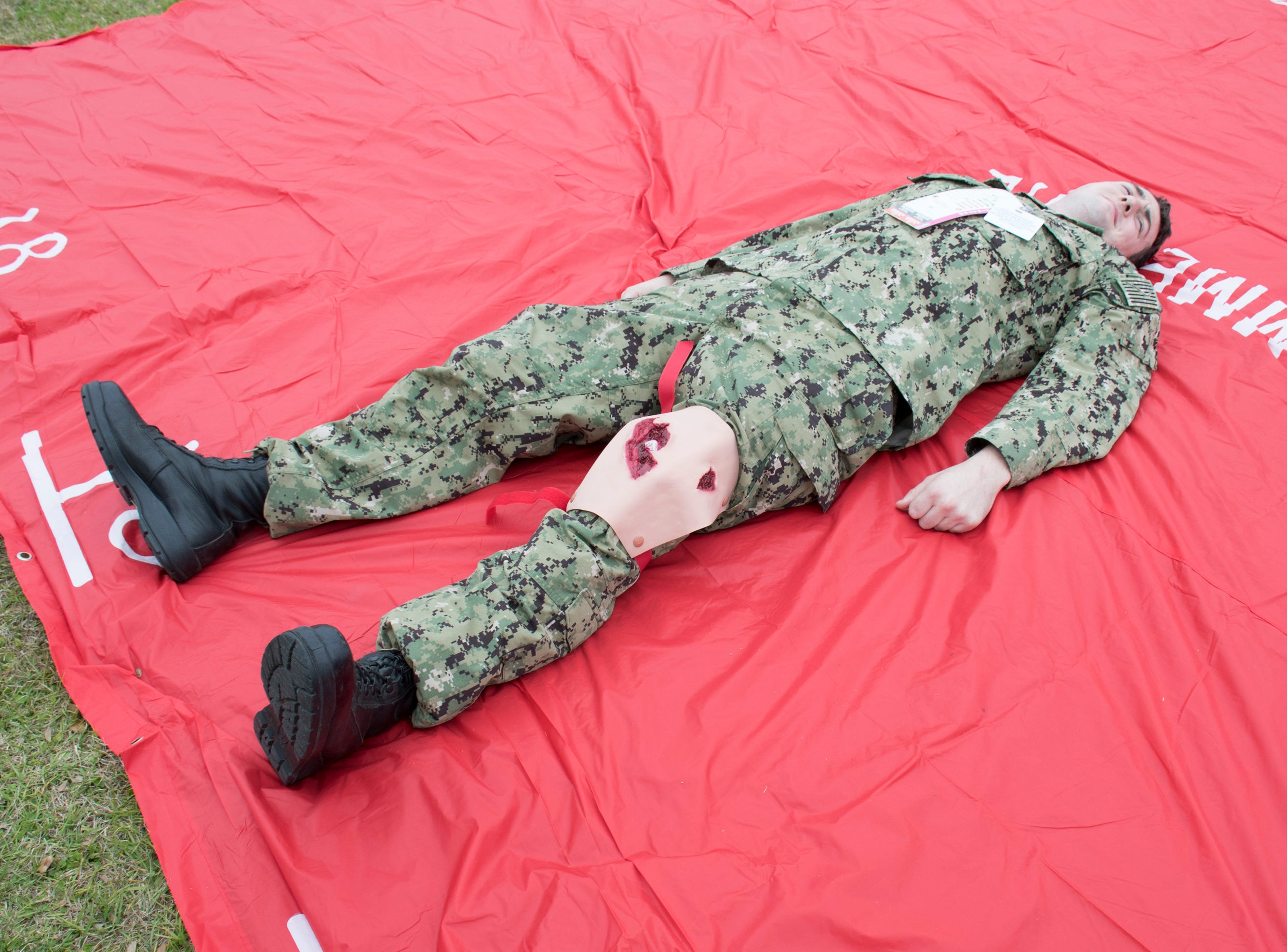 A sailor acting as a casualty lays wounded in the triage area during Exercise Solid Curtain-Citadel Shield, an annual security exercise is conducted at NAS Pensacola on Tuesday, February 4, 2019.