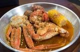 Juicy Seafood at 204 E. Nine Mile Rd. invites customers to sit down over their paper table covers and dig into their low country Cajun seafood boils.
