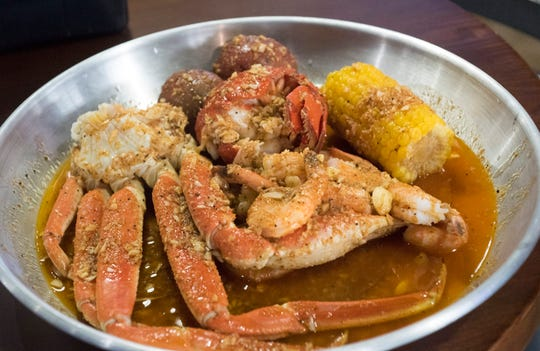 The lobster combo is one of the menu items available on the menu at Red Crab Juicy Seafood, which recently opened on Nine Mile Road.