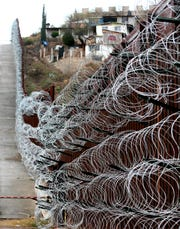 The additional concertina wire can be seen on the border fence in Nogales, Ariz, on February 4, 2019. U.S. Army troops were back in downtown Nogales over the weekend to add more coils of the wire.
