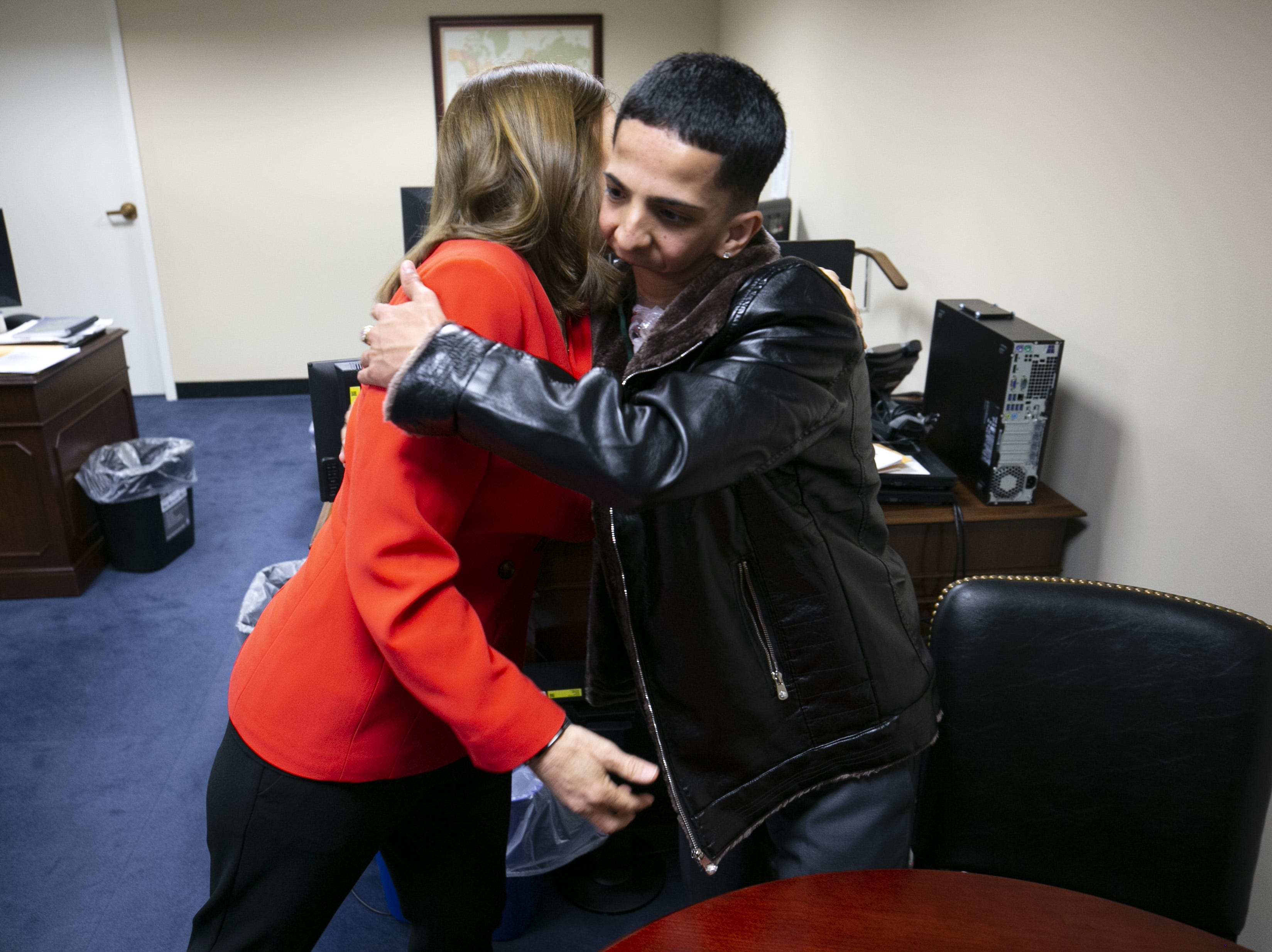 U.S. Sen. Martha McSally, R-Ariz., hugs rapper Isaiah Acosta at McSally's D.C. office.