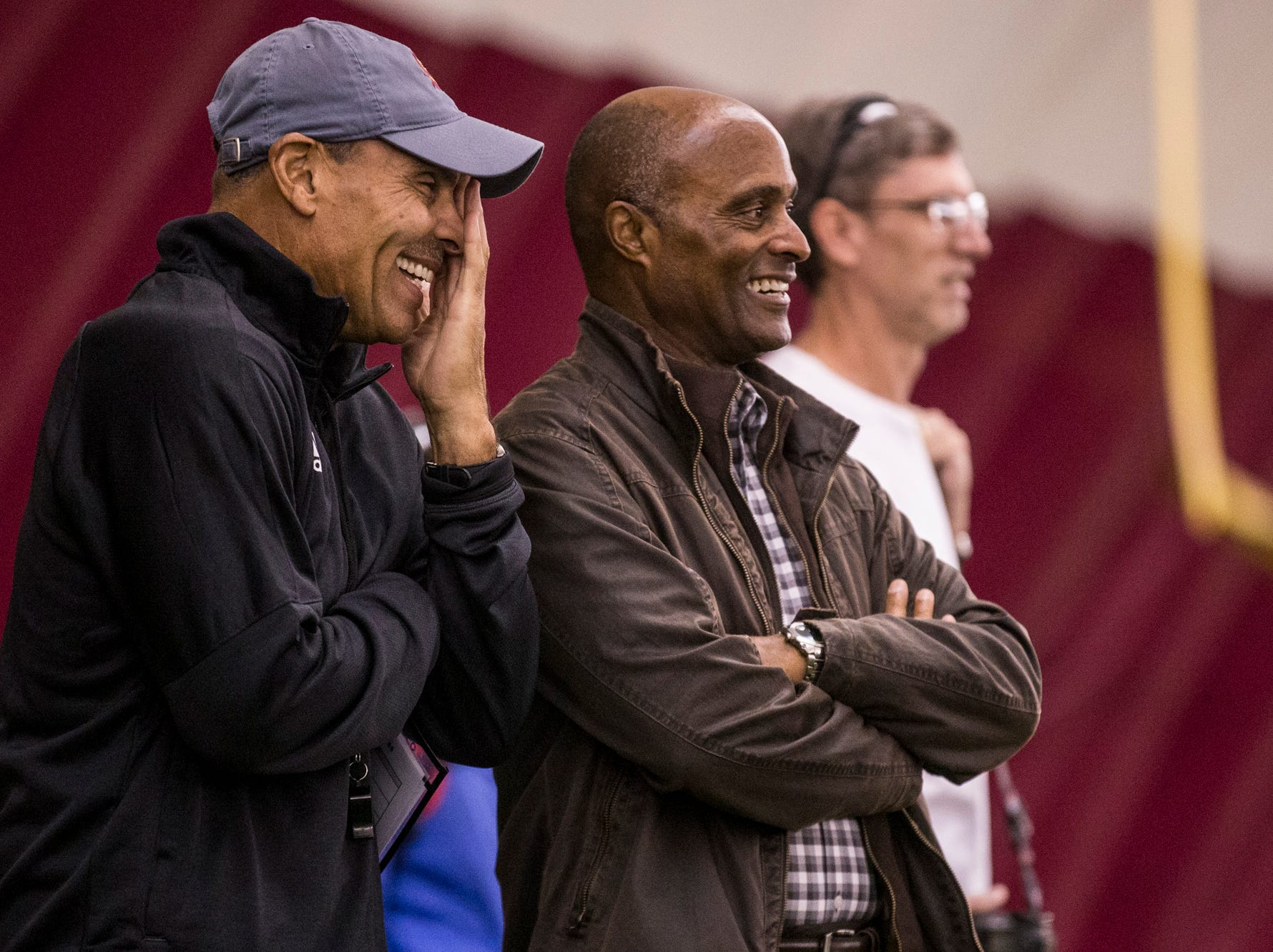 Head coach Herm Edwards laughs with athletic director Ray Anderson during practice on Tuesday, Feb. 5, 2019, at the Verde Dickey Dome in Tempe, Ariz.