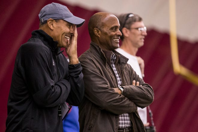ASU head coach Herm Edwards laughs with ASUVice President for Athletics Ray Anderson during practice on Feb. 5, 2019, at the Verde Dickey Dome in Tempe.