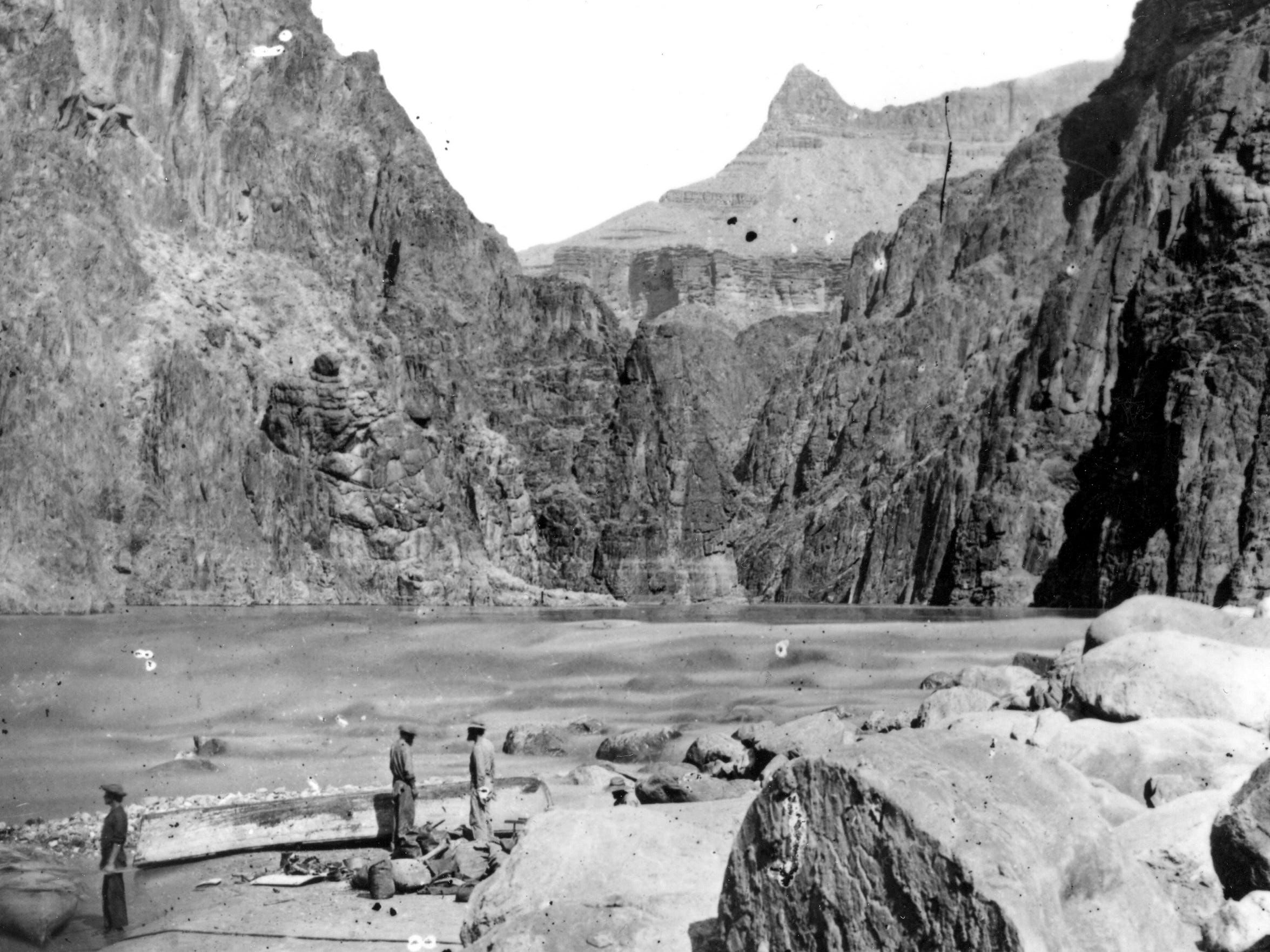 Members of John Wesley Powell's second expedition though the Grand Canyon repair boats in the first granite gorge, 1872.