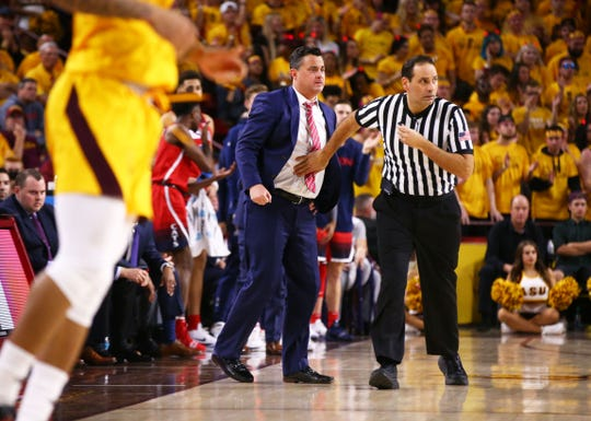 Arizona head coach Sean Miller is pushed back to the sideline against Arizona State in the second half on Jan. 31 at Wells Fargo Arena in Tempe.