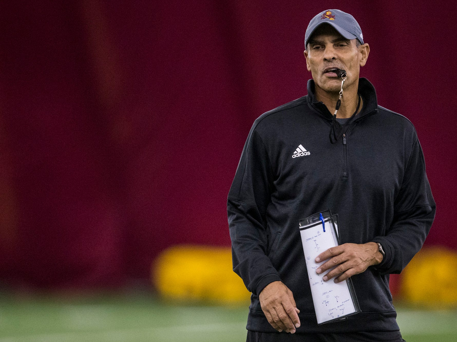 Head coach Herm Edwards watches practice on Tuesday, Feb. 5, 2019, at the Verde Dickey Dome in Tempe, Ariz.
