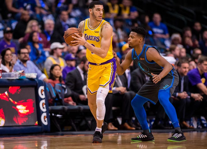 Lakers guard Lonzo Ball is defended by Mavericks guard Dennis Smith Jr. during a game Jan. 7 at American Airlines Center.
