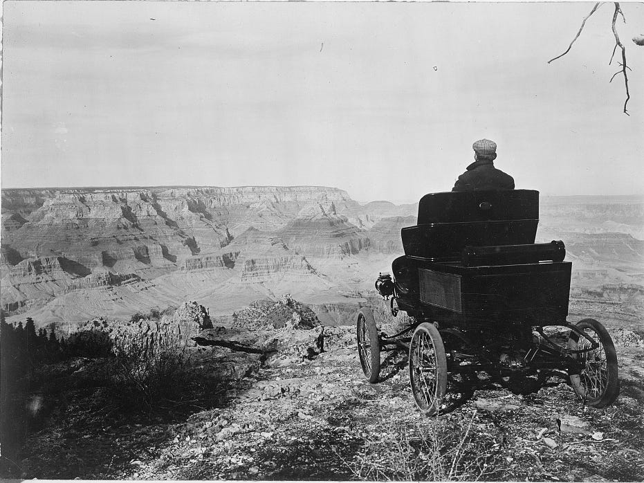 A steam-powered Toledo perches on the edge of the Grand Canyon in this 1902 photo. Early cars had to navigate roads built for the stagecoach.