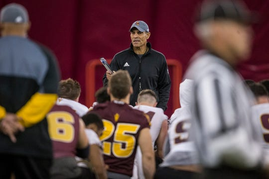 Head coach Herm Edwards talks to players after practice on Tuesday, Feb. 5, 2019, at the Verde Dickey Dome in Tempe, Ariz.