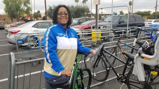"Tempe resident Rebecca Levasseur, who purchased a padded bicycle seat on a recent trip to Walmart, said she supports a food tax ban because ""eating is not optional."""